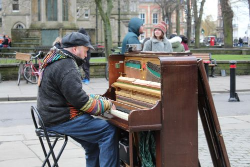 man playing piano in park